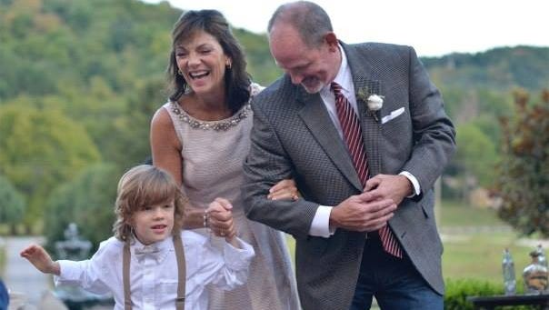 Eban Skor, left, with foster parents Sheri and Chandler Means at the September 2014 wedding of one of the Means' biological daughters, Chaney Dykes.