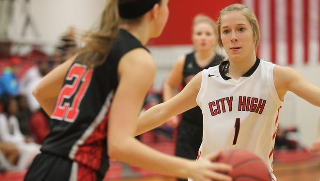 City High's Sarah Plock guards Linn-Mar's Brittney Lancial during their game on Tuesday, Dec. 16, 2014. David Scrivner / Iowa City Press-Citizen