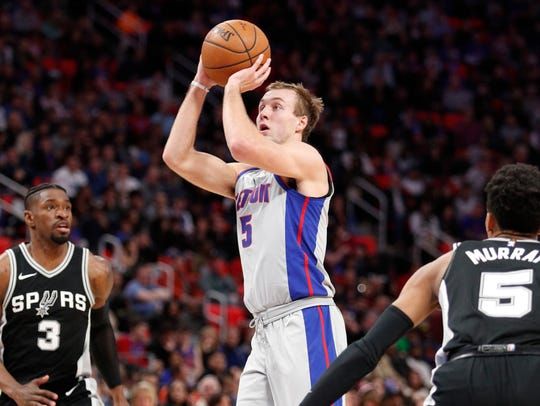 Pistons guard Luke Kennard (5) takes a shot in between