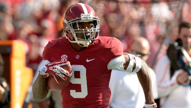 Alabama wide receiver Amari Cooper (9) takes a pass 54 yards for a touchdown against Tennessee during the first quarter Saturday at Bryant-Denny Stadium.