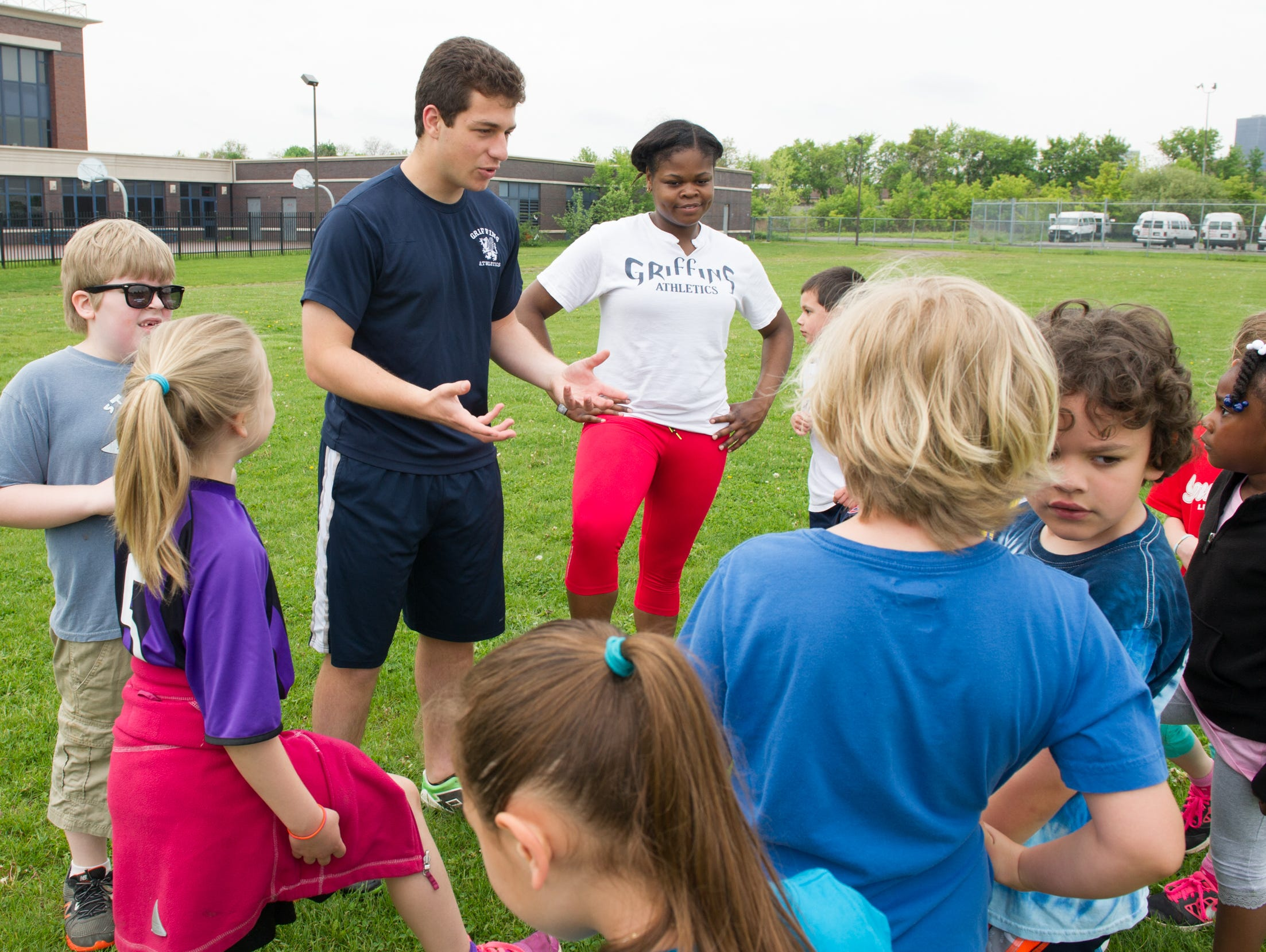 World of Inquiry senior Jason Cherin, 18, of Rochester runs a series of soccer clinics in the city of Rochester for grades K-12. His best friend, senior Quinterra Robinson, 18, of Rochester, right, is one of his assistant coaches.