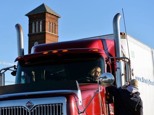 Shelly Truck Driving School trainee Connie Watson of Lancaster County operates a tractor-trailer for a parallel-parking exercise as manager and lead instructor Jim Burness offers directions during an instruction period on Oct. 30,. at the school's yard in York City.