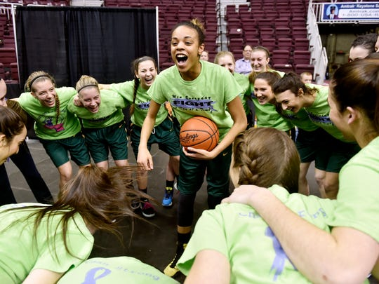 York Catholic's Jania Wright leads her teammates in a cheer prior to warmups before Thursday's District 3 Class AA title game.