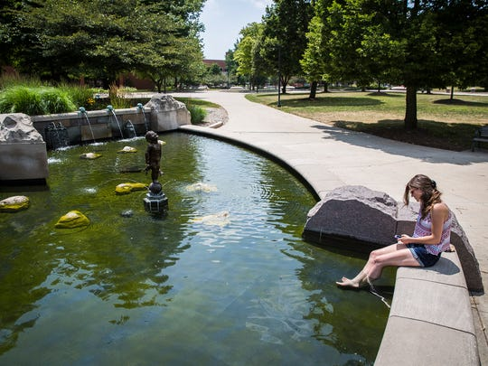 Brittany Wiggins cools off in the Frog Baby fountain