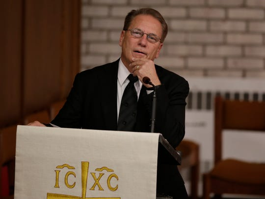 Michigan State men's basketball coach Tom Izzo eulogizes Detroit Free Press sports columnist Drew Sharp at his funeral Thursday, Oct. 27, 2016, at Beautiful Savior Lutheran Church in Bloomfield Hills.