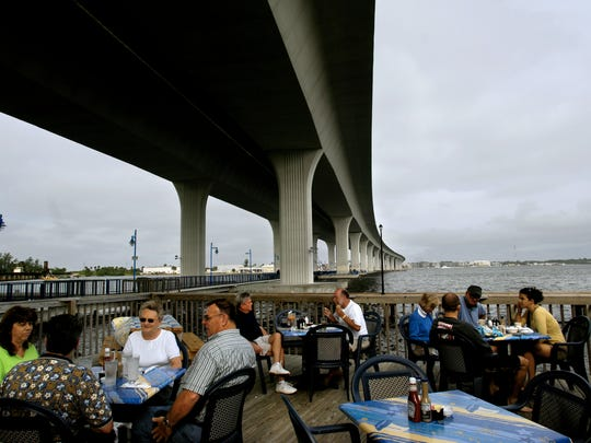 At Stuart's Pelican Café, tiny terriers and large great Danes enjoy the activities and aroma of the riverside boardwalk and bustling restaurant.