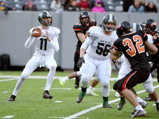 New Milford quarterback Ryan Picinic #11 drops back for a pass during the North 1 Group 1 state championship game  against New Milford at MetLife Stadium on Sunday, December 4, 2016.