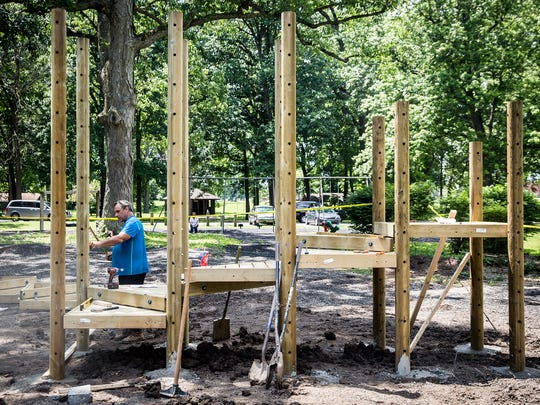 Contractors begin construction on West Side Park's new playground Wednesday afternoon.