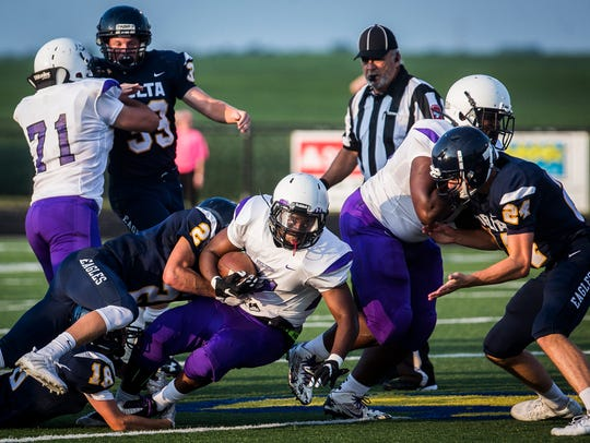 Central's Xavier Cleaves is tackled into lineman DJ