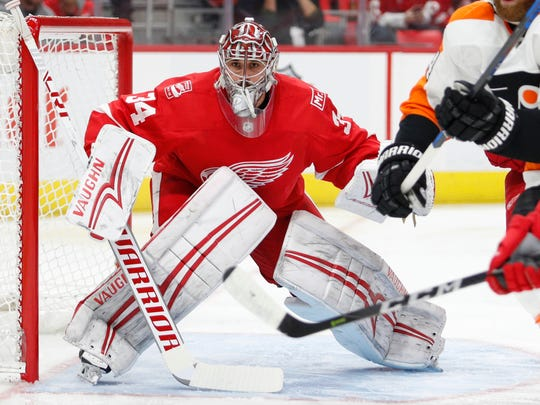 Red Wings goaltender Petr Mrazek (34) protects the net during the first period on Tuesday, Jan. 23, 2018, at Little Caesars Arena.