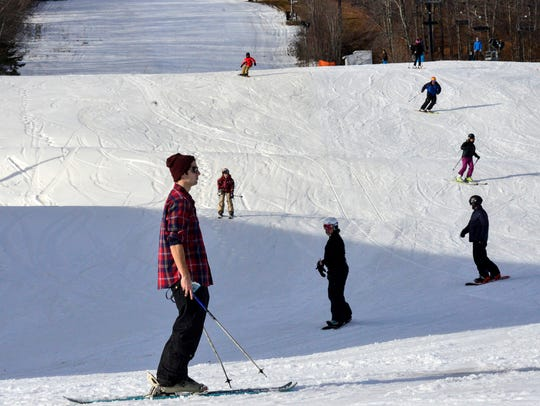 Skiers take to warmer-than-usual slopes at Mount Snow