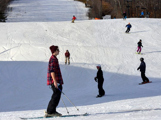 Skiers take to warmer-than-usual slopes at Mount Snow Resort in West Dover, Vt. on Friday.