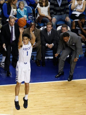 Kentucky guard Devin Booker shoots a three point basket with a distraught Providence head coach Ed Cooley, left, watching on. The University of Kentucky Men's Basketball team hosted Providence, Sunday, Nov. 30, 2014 at Rupp Arena in Lexington. Photo by Jonathan Palmer, Special to the CJ
