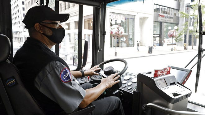 COTA bus driver Mark Evans heads down North High Street in Columbus, Ohio on July 22, 2020.