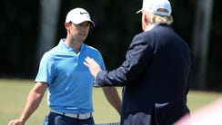 Donald Trump talks to Rory McIlroy during the final