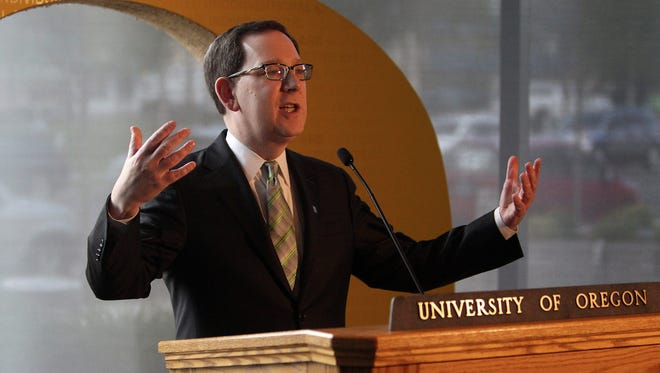 Michael Schill speaks at a news conference after being introduced as the 18th president of the University of Oregon inside the Ford Alumni Center on the campus of the University of Oregon in Eugene, Ore. Tuesday, April 14, 2015. Schill is formerly dean of the University of Chicago Law School.