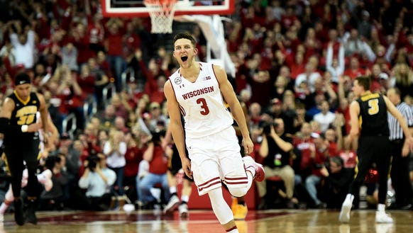 Zak Showalter of the Wisconsin Badgers reacts to a