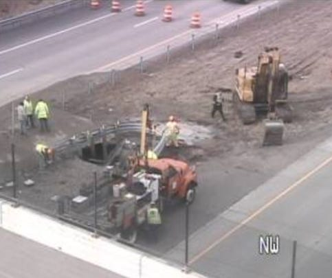 A traffic camera shows the scene on Interstate 684 at 15th Street North in Oakdale. A large sinkhole opened up Sunday caused by a water main break. Traffic is being diverted. This photo was taken at 1:30 p.m. Sunday, Dec. 3.