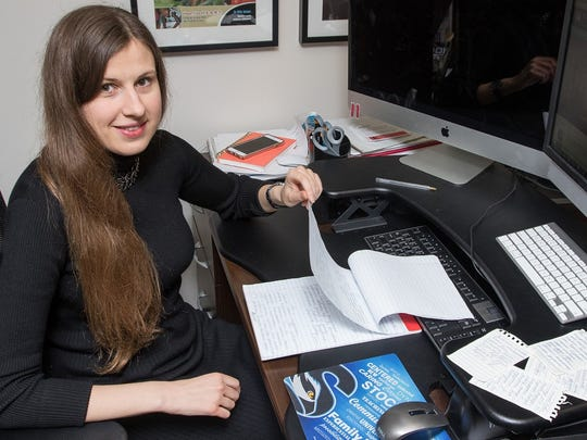 Darya Hrybava, a Stockton University employee, translates thank-you notes written by Russian travelers at Atlantic City International Airport.