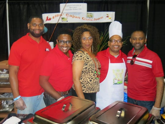 Pausing to pose at Ellis Cajun Quiche Booth at Cooking Classic: Dr. Alan Jackson, Larry Ellis, Linzola Winzer, Southern University Shreveport Chancellor Dr. Rodney A. Ellis, presiding at his booth, and Demario Tyson.