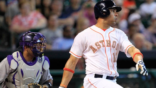 Former Houston Astros first baseman Carlos Pena hits a two-RBI double against the Colorado Rockies during the fourth inning at Minute Maid Park.