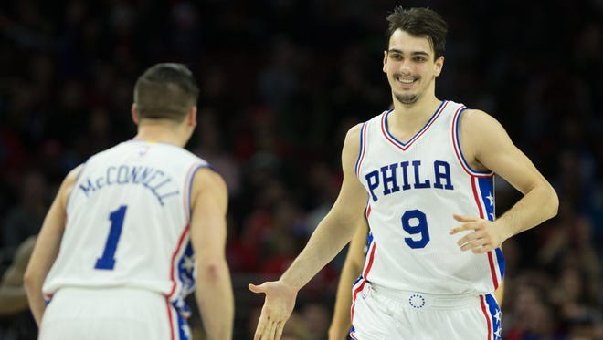 Philadelphia 76ers forward Dario Saric (9) reacts with guard T.J. McConnell (1) after his score against the LA Clippers during the fourth quarter at Wells Fargo Center.