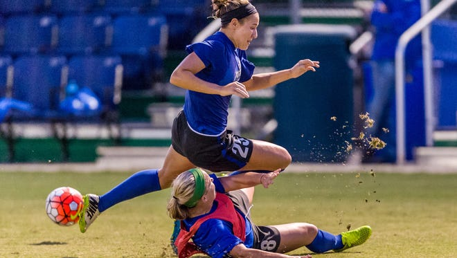 FGCU forward Tabby Tindell hurdles a tackle from defender Emma Blackwell during the team's first practice, Wednesday, Aug. 5.