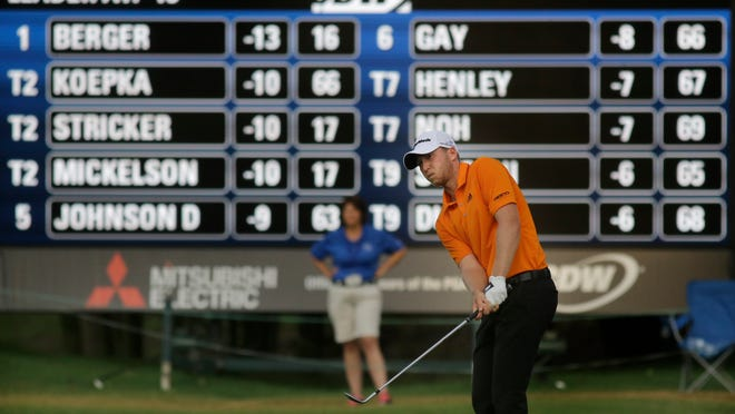 Daniel Berger hits a chip shot on the 17th green at the FedEx-St. Jude Classic in Memphis on June 12, 2016.