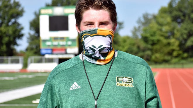 Former Missouri offensive lineman Jonah Dubinski poses for a photo Monday morning at Rock Bridge's Sells Field.
