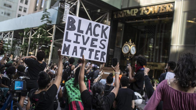 Protesters march in front of Trump Tower in New York in May during a solidarity rally for George Floyd, the Black man who was killed in police custody in Minneapolis.