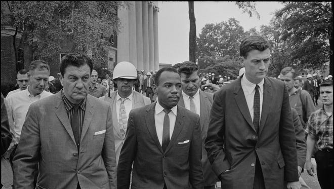 U.S. Marshal Robert McShane and Justice Department official John Doar escort James Meredith into the University of Mississippi in fall 1962.