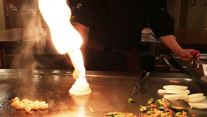 Hibachi chef Sung Chang prepares a flaming onion volcano at Kiku of Tokyo in Sheboygan.
