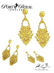 Part of the online auction, these 18K gold earrings with diamond accents are designed by William Boyajian for Port Royal Jewelers.