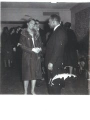 The Rev. Martin Luther King Jr. greets Maxine Vincent's mother, Cecil Abston, during his visit to Albion College on March 13, 1963.