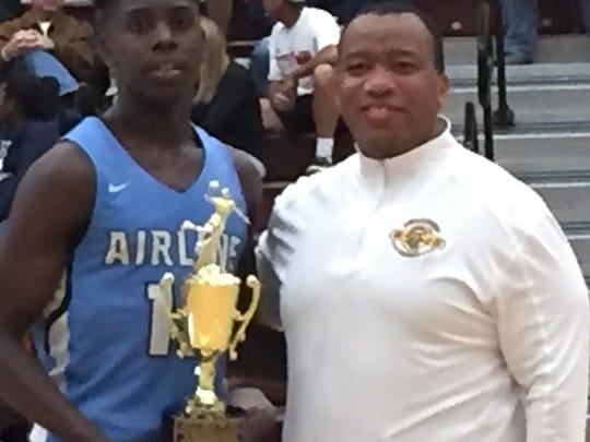 Airline's Trent Ivy accepts the MVP trophy from Mike Theus.