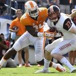 Tennessee linebacker Darrin Kirkland Jr. (34) stops Bowling Green quarterback Matt Johnson (11) during the first half against Bowling Green in Nissan Stadium in Nashville Saturday, Sept. 5, 2015. (AMY SMOTHERMAN BURGESS/NEWS SENTINEL)