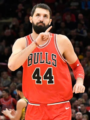 Chicago Bulls forward Nikola Mirotic (44) reacts after making a three-point basket against the Indiana Pacers during the first half at United Center.