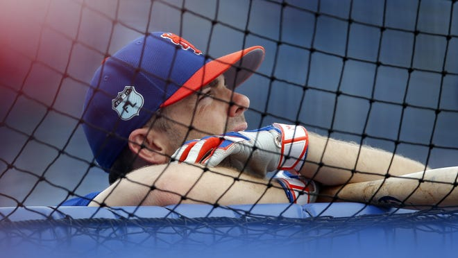 New York Mets third baseman David Wright watches batting practice before a spring training baseball game against the Washington Nationals Monday, March 27, 2017, in Port St. Lucie, Fla. (AP Photo/John Bazemore)