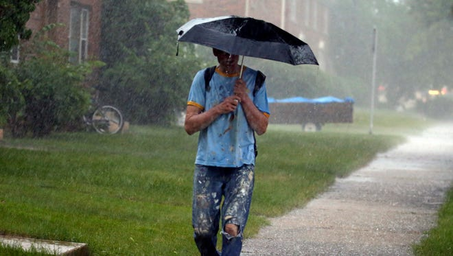 """""""This is incredible,"""" exclaims a wet Jeff Raffone as he makes his way home Monday through heavy rain from 70th and Lisbon to over a mile away at 56th and Garfield."""