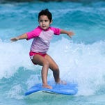 Kids compete in the 5th annual O'Neill Mañahak Surf Contest in the wave pool at the Onward Beach Resort Water Park on Dec. 5.