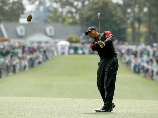 Tiger Woods hits on the first fairway during the fourth round at the Masters golf tournament Sunday, April 8, 2018, in Augusta, Ga. (AP Photo/Charlie Riedel)