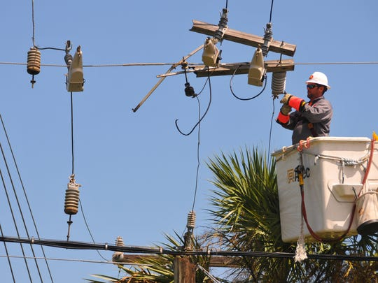 Workers from Extreme Powerline Construction out of Michigan, is just one of the out of state crews assisting FP&L restoring power to Brevard County. The crew was working to restore a main feeder line to a neighborhood on Fiske Blvd. in Rockledge.