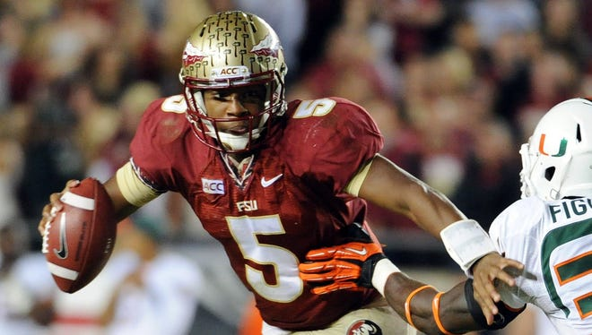 Florida State quarterback Jameis Winston (5) evades Miami linebacker Alex Figueroa (36) during the second half Nov. 2 at Doak Campbell Stadium. Eleven days later, an investigation into an alleged Dec. 7, 2012 sexual battery incident was launched.