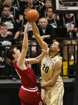 Purdue Boilermakers center A.J. Hammons blocks a shot on Indiana Hoosiers forward Max Hoetzel in the second half. Purdue hosted Indiana at Mackey Arena Wednesday, January 28, 2015.
