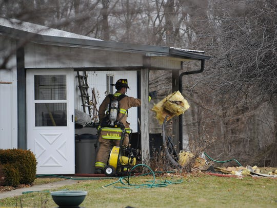 Firefighters responded to a garage fire Friday afternoon, Jan. 23, 2015, at 6310 Indian Run Rd NE. A 100-gallon propane tank was damaged in the blaze. No one was injured in the fire.