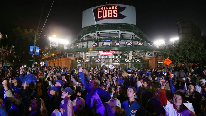 A raucous atmosphere is expected at Wrigley Field on Friday night as the Cubs play their first World Series game at the ballpark since 1945.