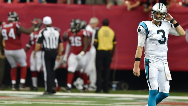Carolina Panthers quarterback Derek Anderson (3) walks off the field after throwing an interception to Atlanta Falcons cornerback Robert Alford (23) during the second half of an NFL football game, Sunday, Oct. 2, 2016, in Atlanta. Alford scored a touchdown on the play. The Atlanta Falcons won 48-33.