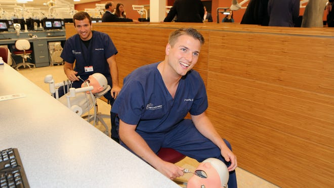 Cody Novotny, left and Tim Litz, first year dental students, check out the simulation lab at the grand opening of the Touro College of Dental Medicine at New York Medical College in Hawthorne, Sept. 28, 2016.