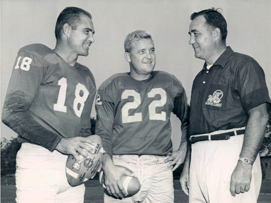 Detroit Lions football players Tobin Rote, Bobby Layne and head coach George Wilson.