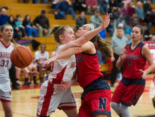 New Oxford's Kaelyn Long collides with Susquehannock's